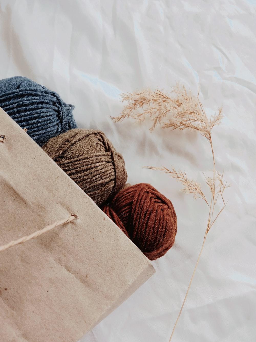 blue, brown, and orange yarn threads