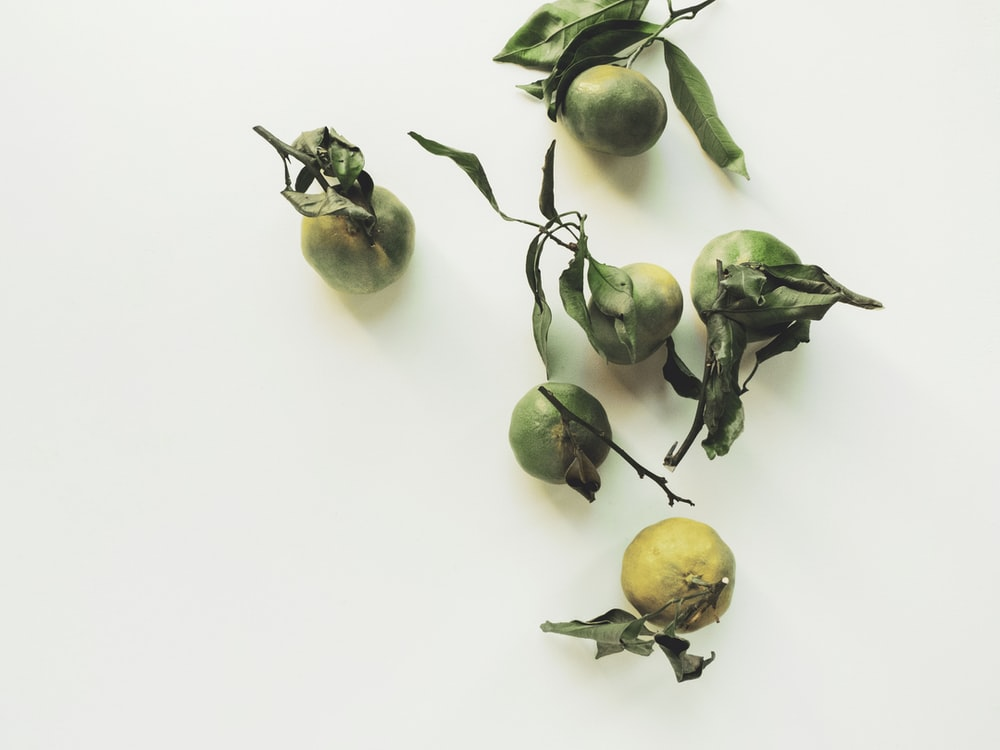 five green and yellow fruits