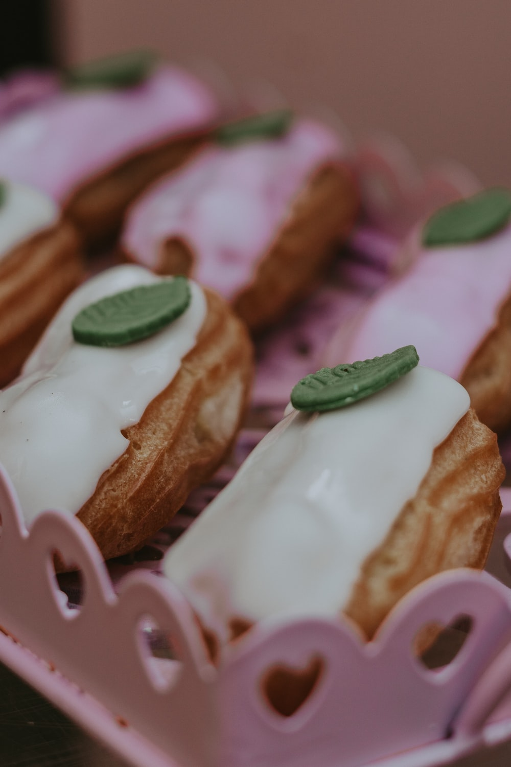 selective focus photography of pastry on pink tray