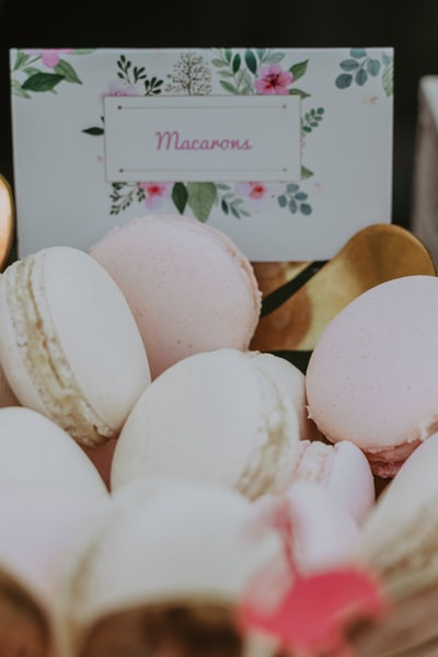selective focus photography of French macarons with box