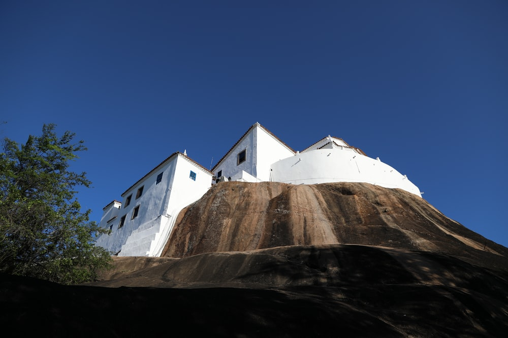 low-angle photography of white and brown concrete house during daytime