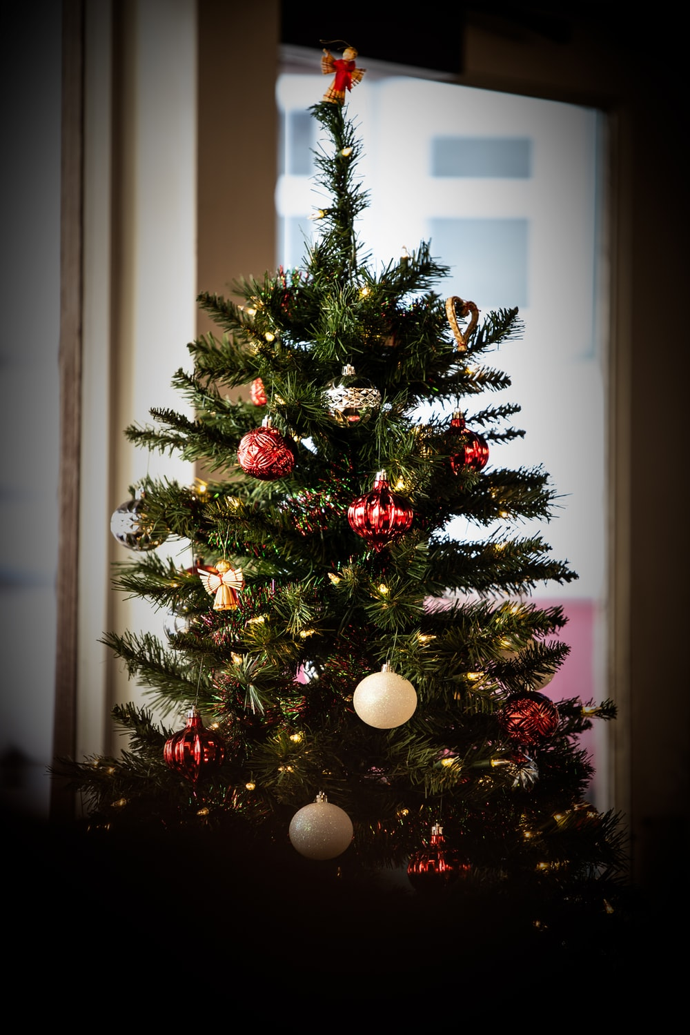 Christmas tree with ornaments indoors