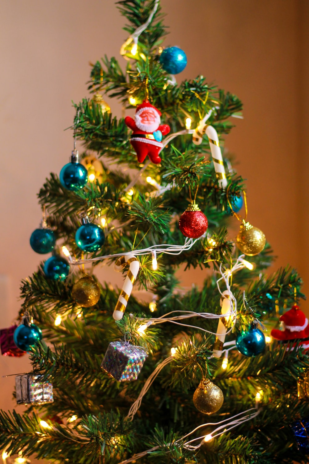 selective focus photography of baubles hanged on Christmas tree