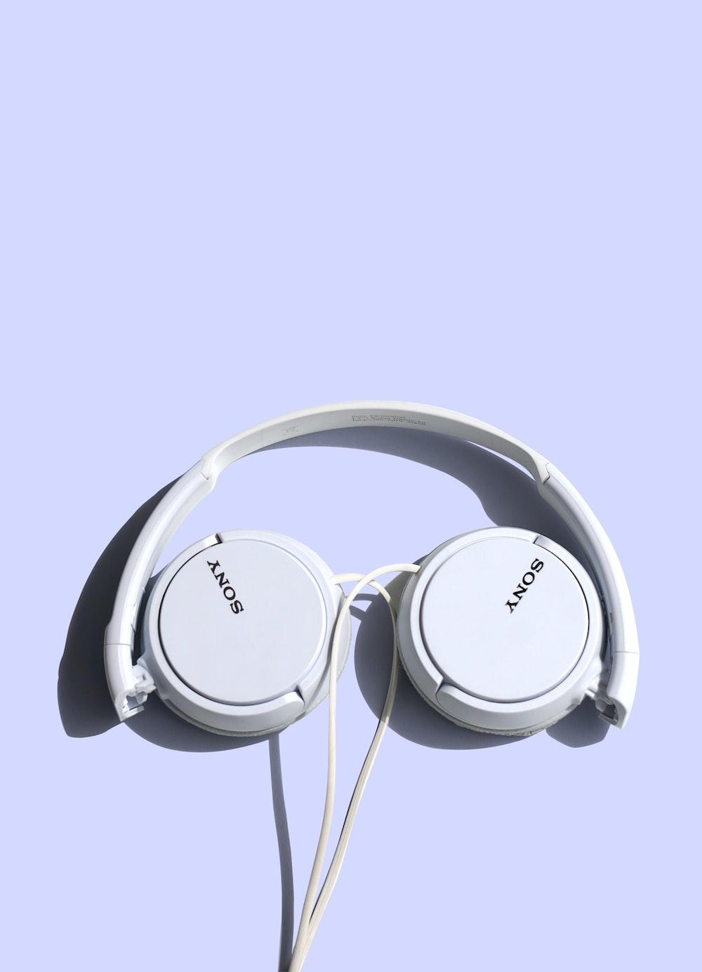 white Sony corded headphones