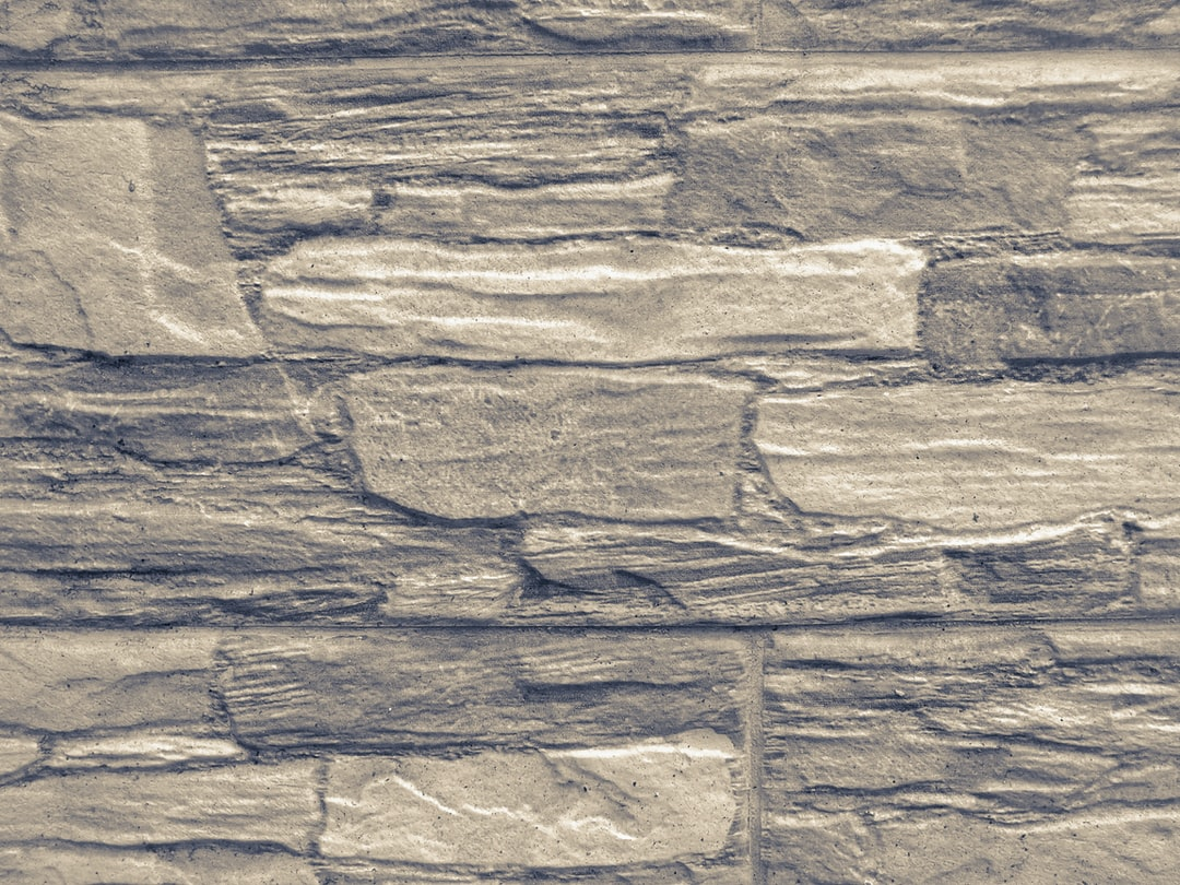 Facade tiles imitating stone texture in pastel tone.