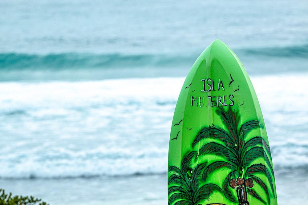 green Isla Muteres surfboard during daytime