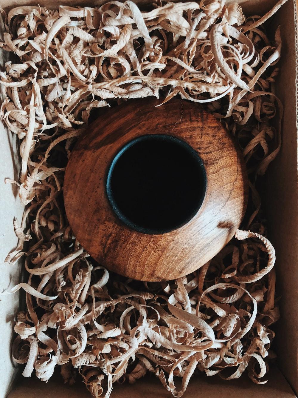 brown vase inside box