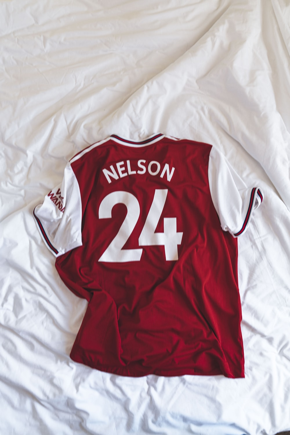 red and white Nelson 24 jersey shirt