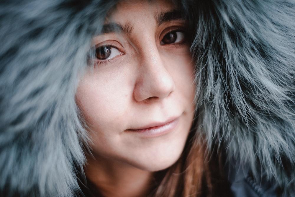 woman in gray fur coat