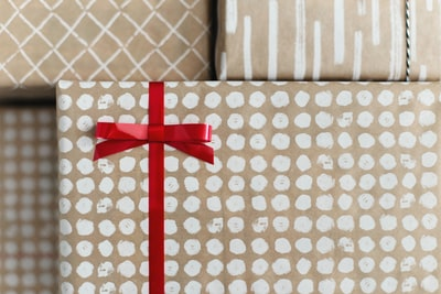 gold and white gift box wrapping paper teams background