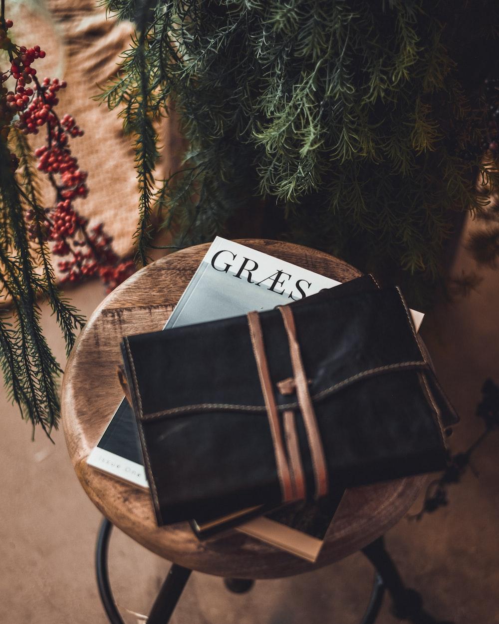 black leather bag on stool