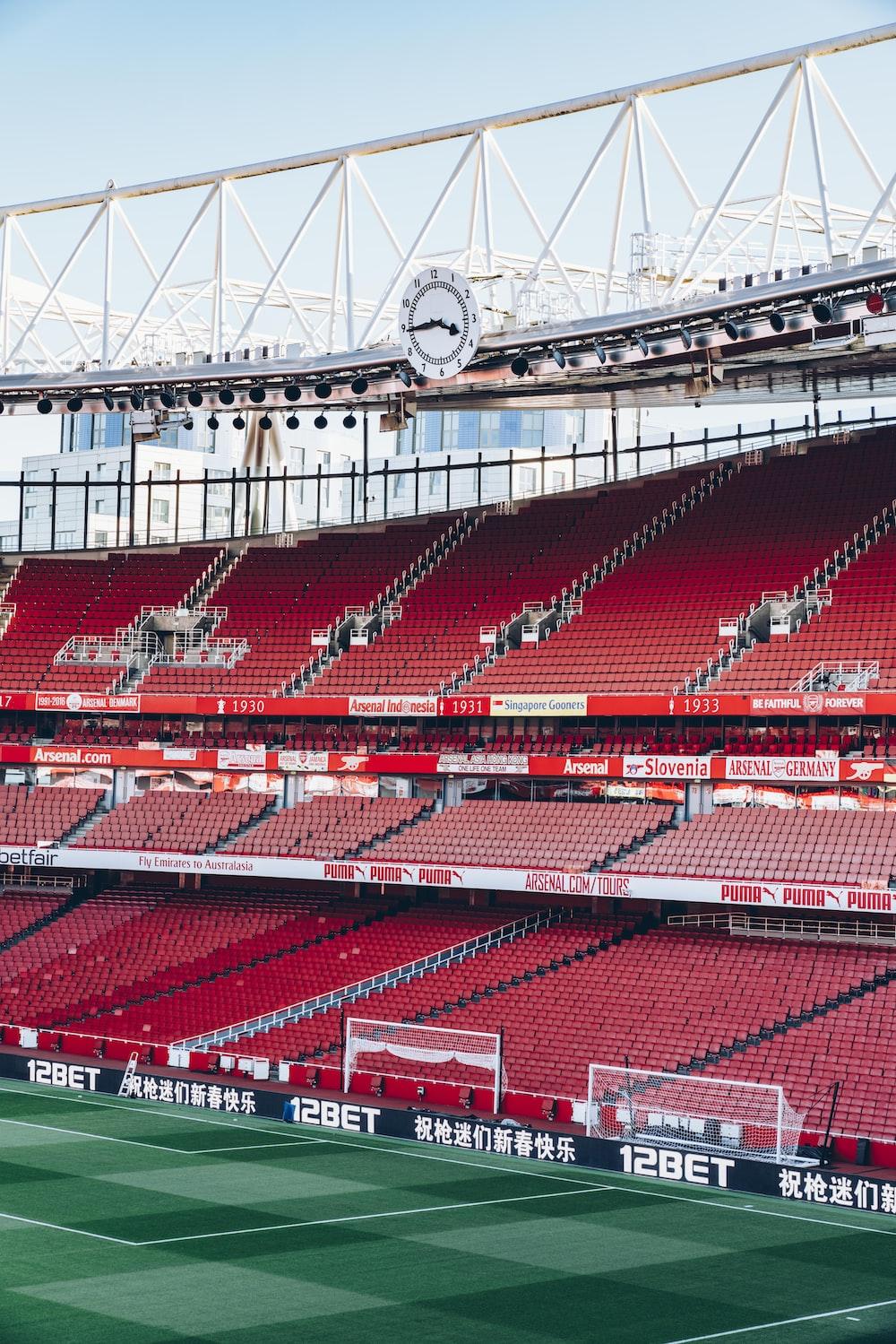 soccer stadium under white and blue sky