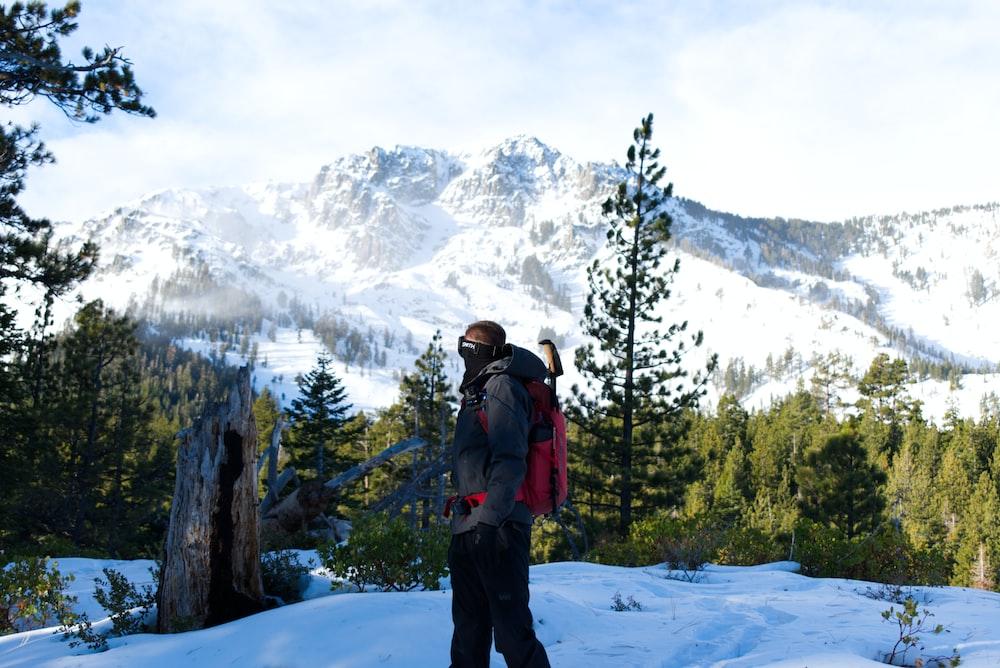 man fronting mountain