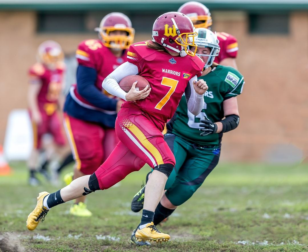 Heather Marini from the Monash Warriors Women's Gridiron, Americain  football team seen here running on her way to a touchdown