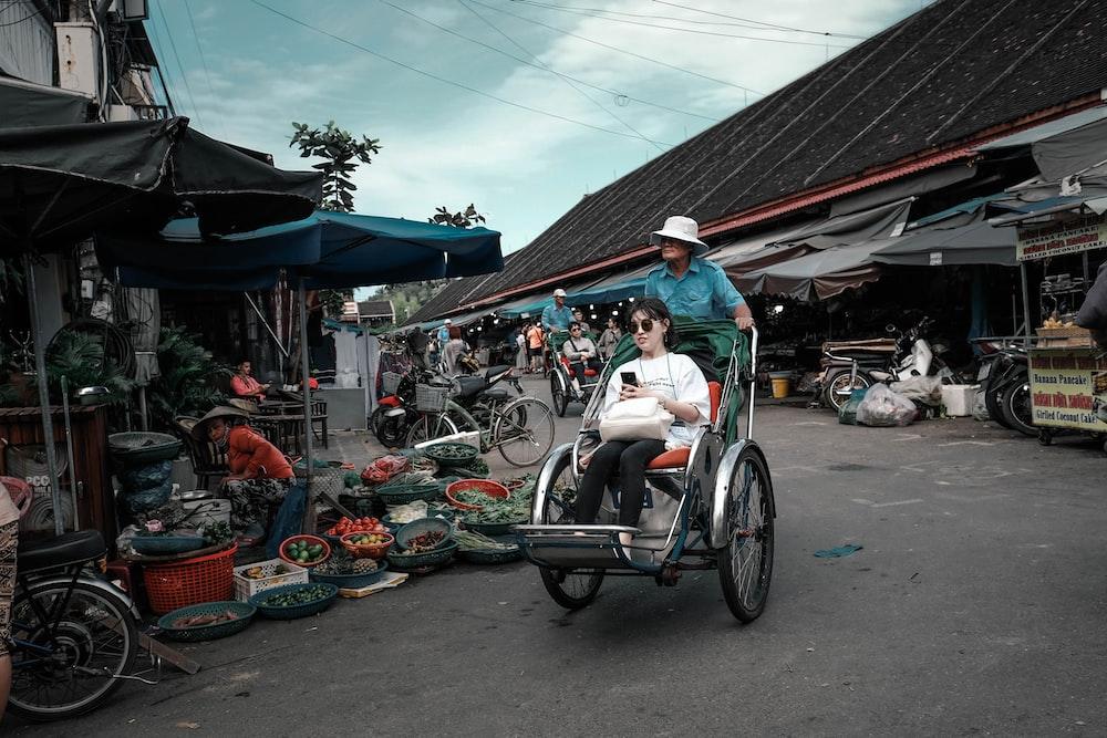 woman sitting on stroller