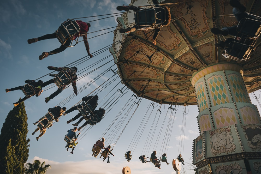 people riding on amusement ride