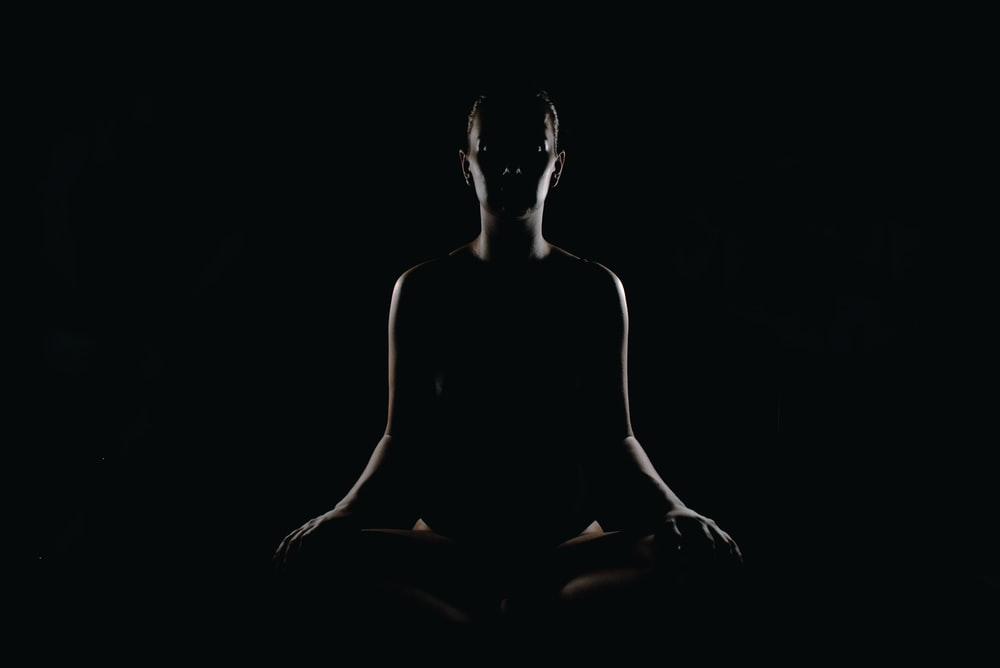 person doing meditation pose