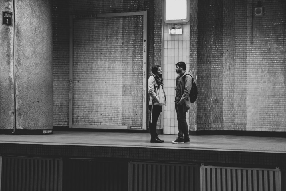 man and woman on train station