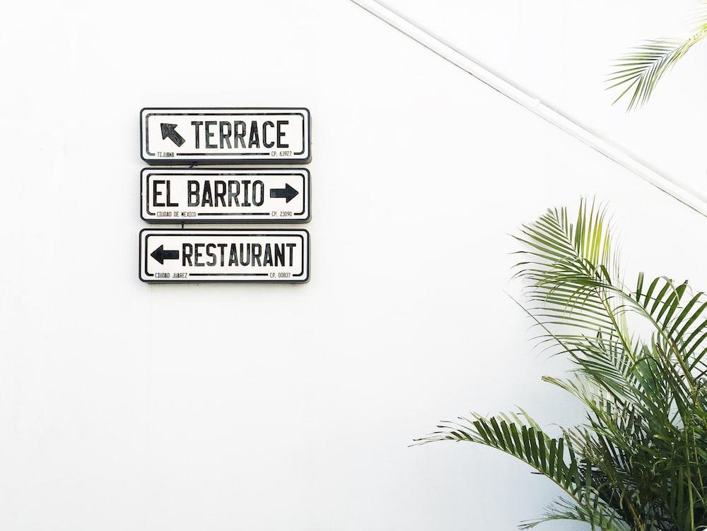 terrace, El Barrio and restaurant signs