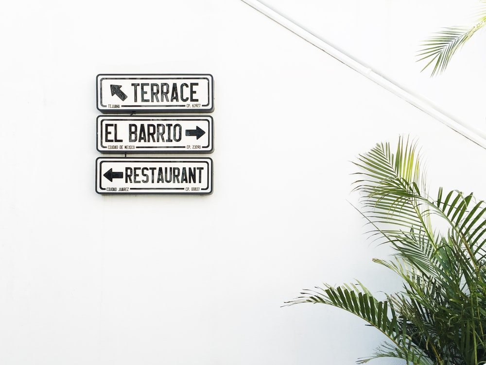 terrace, El Barrio and restaurant signs