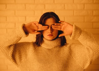 woman in white turtleneck knitted jacket