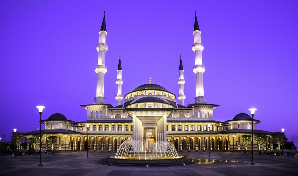 gold mosque during night time