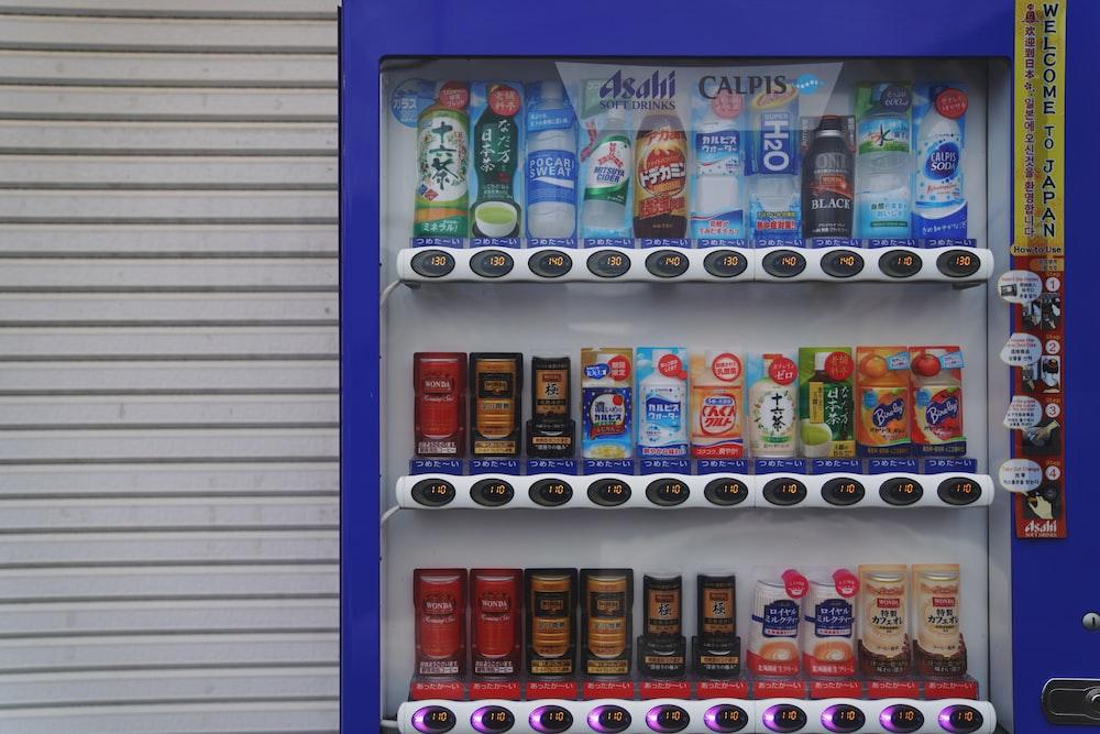 assorted-brand beverages inside beverage cooler