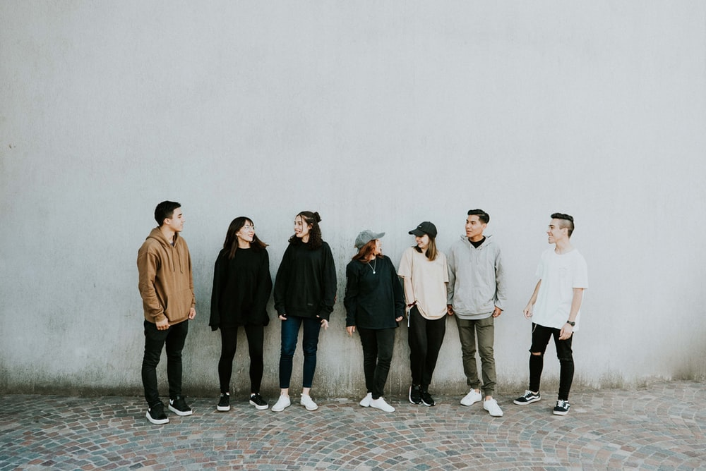 people standing near wall