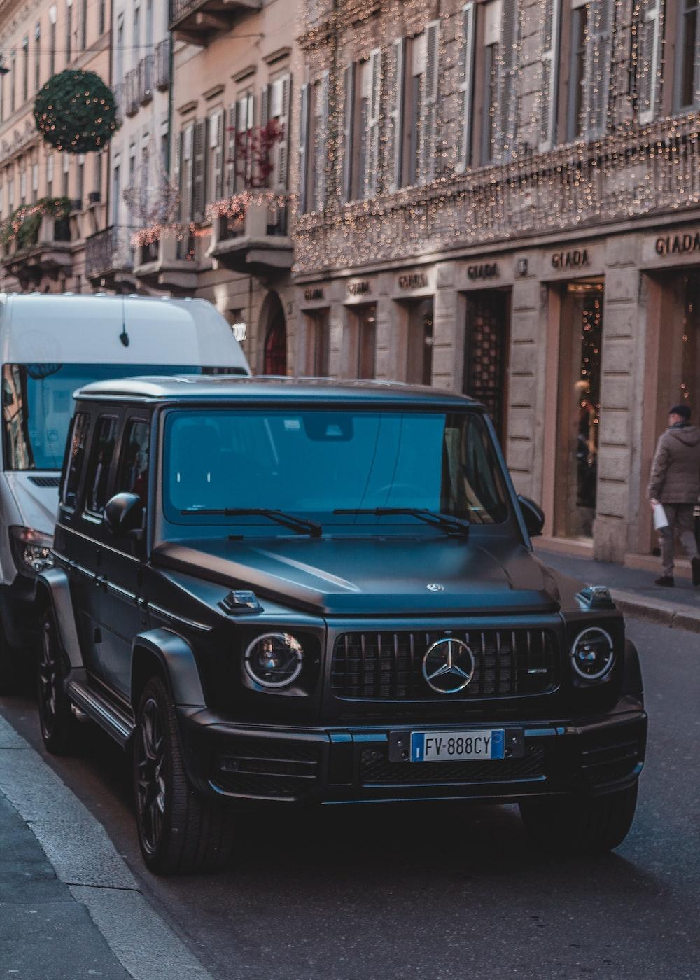 Mercedes-Benz SUV parked on sidewalk