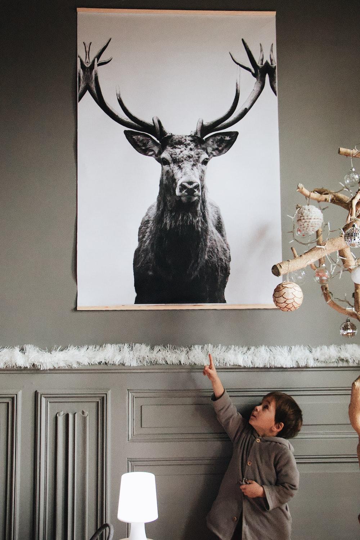 boy pointing Deer painting