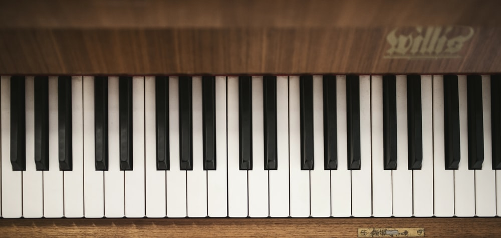 brown, white, and black piano keys