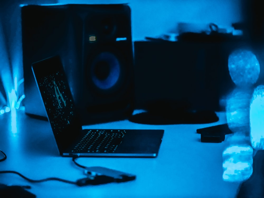 black laptop computer on desk