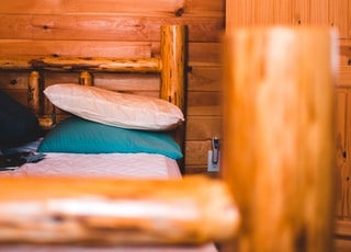 pillows on top of bed with wooden frame