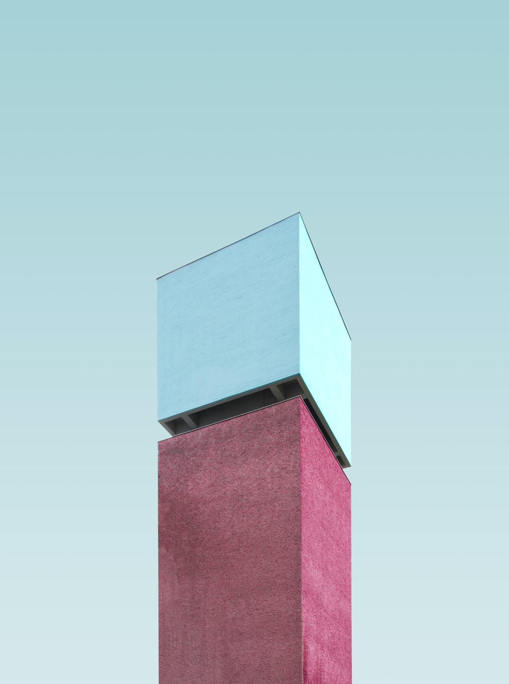 pink and gray tower during daytime