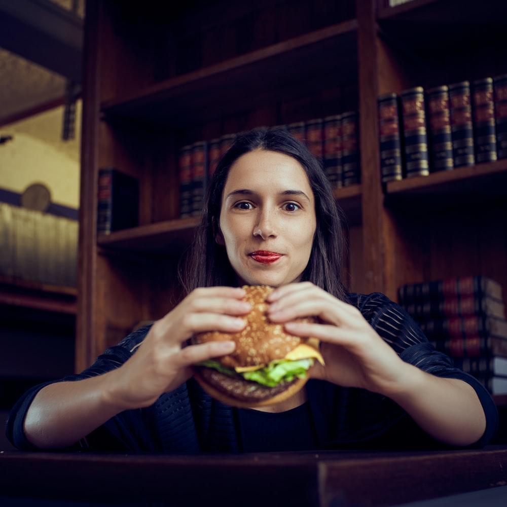 woman holding hamburger