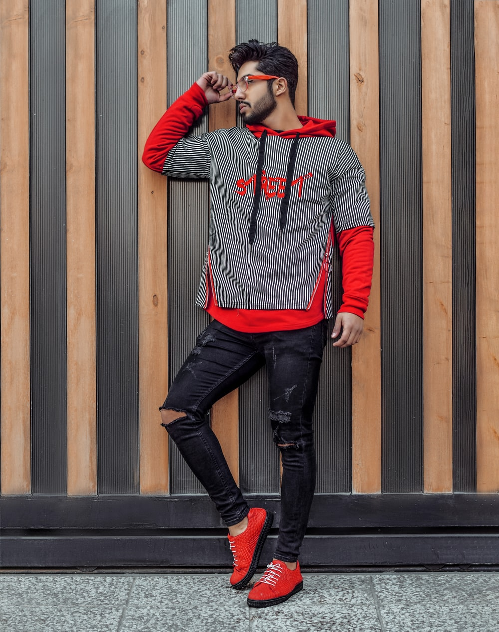 shallow focus photo of man in gray and red pullover hoodie