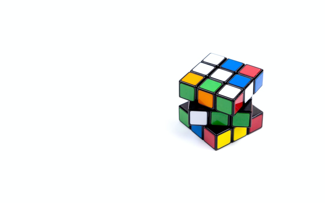 Game multi-colored cube on a white background. Game concept with copy space for text