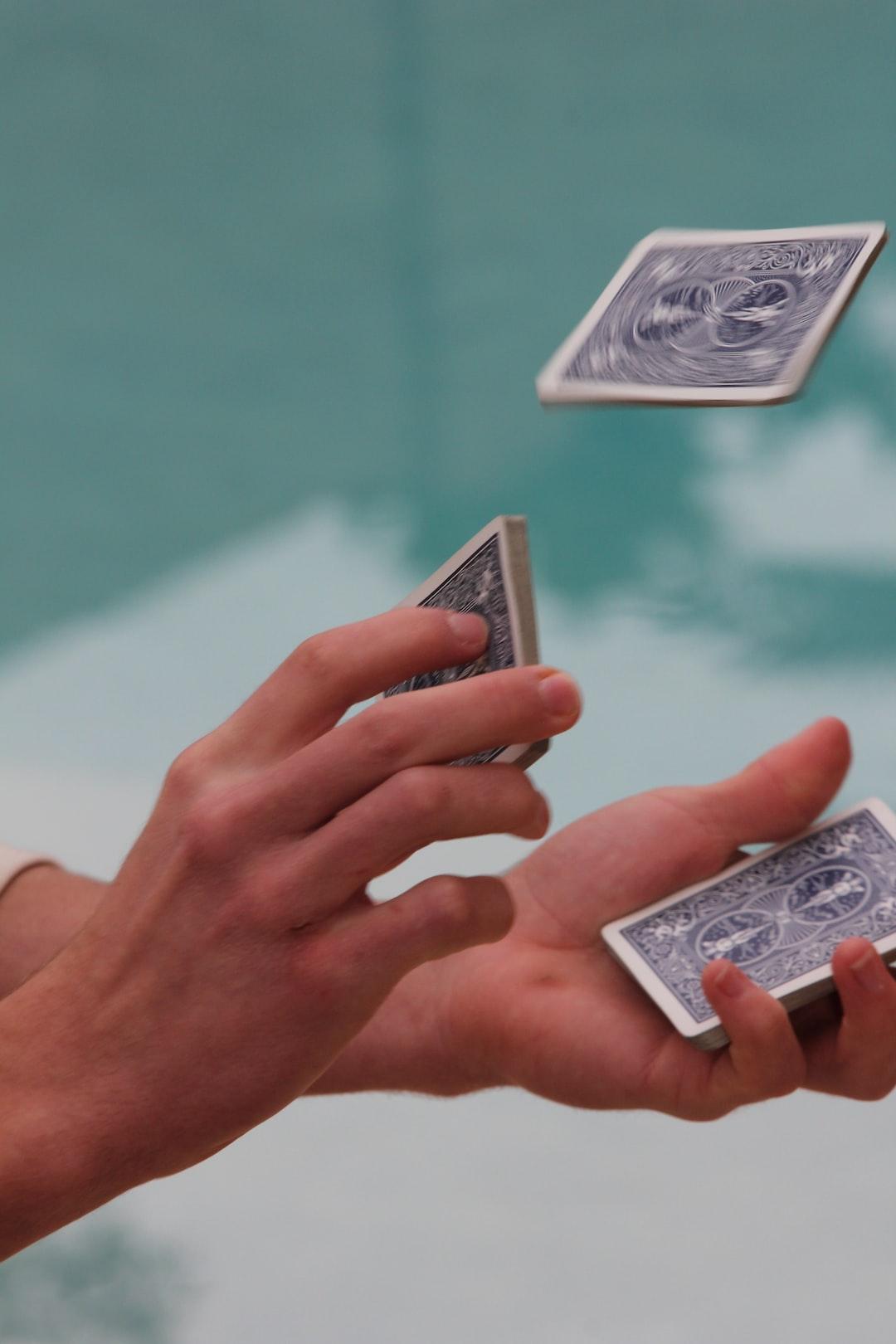 A boy shuffles a deck of cards.