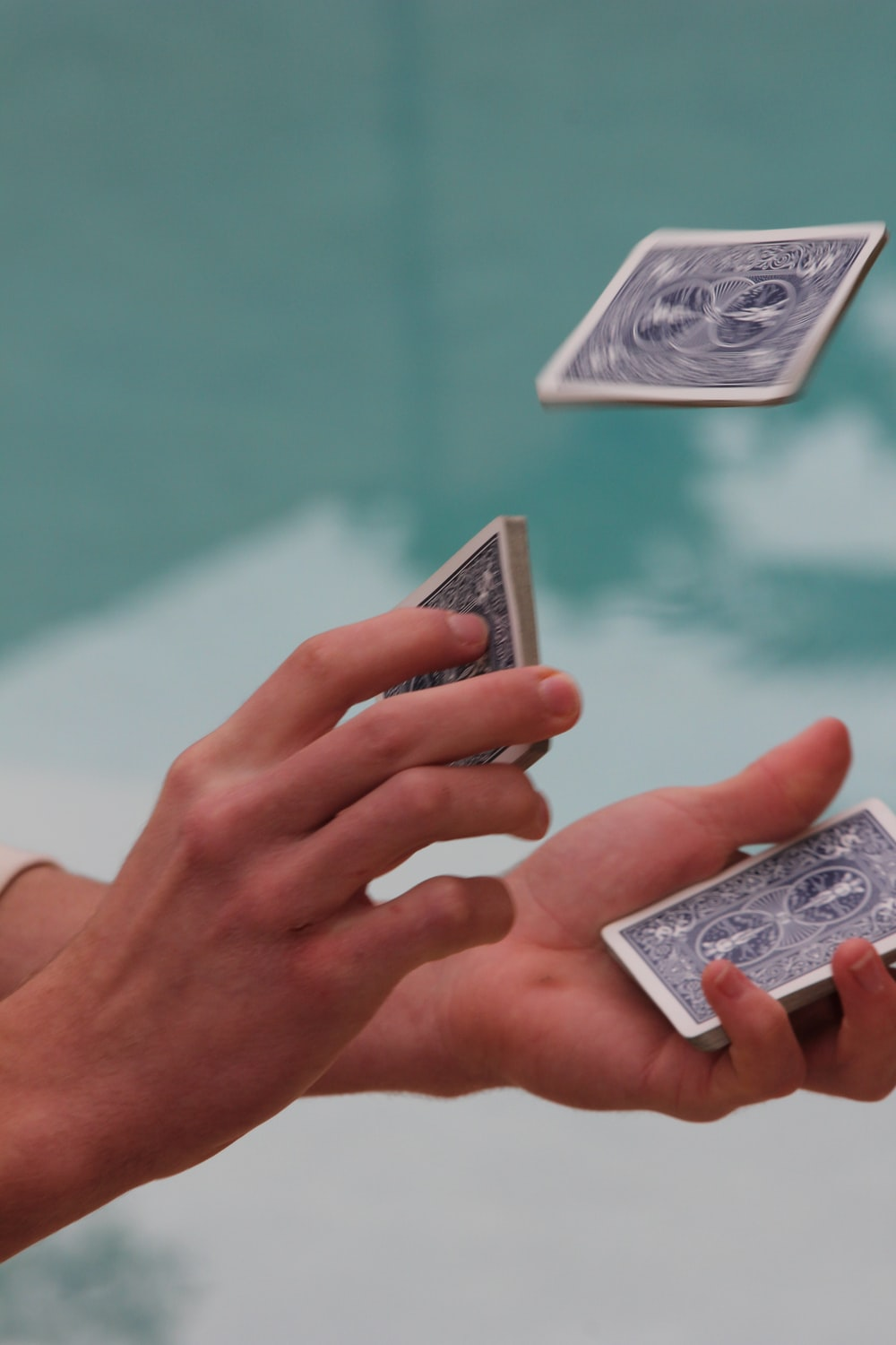 unknown person shuffling playing cards