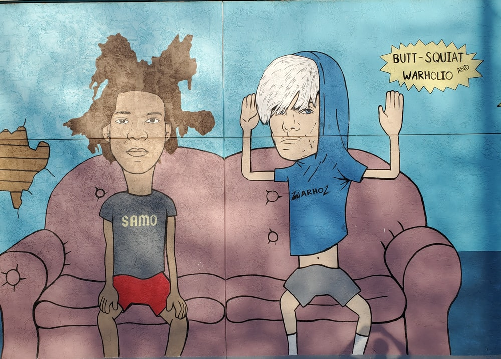 two men sitting on brown couch cartoon meme