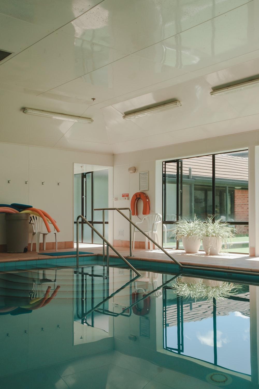 rectangular green indoor swimming pool