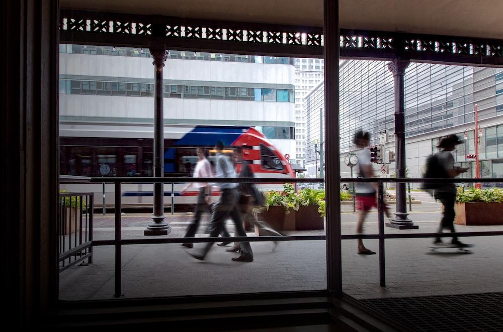 people walking on pathway near buildings during daytime