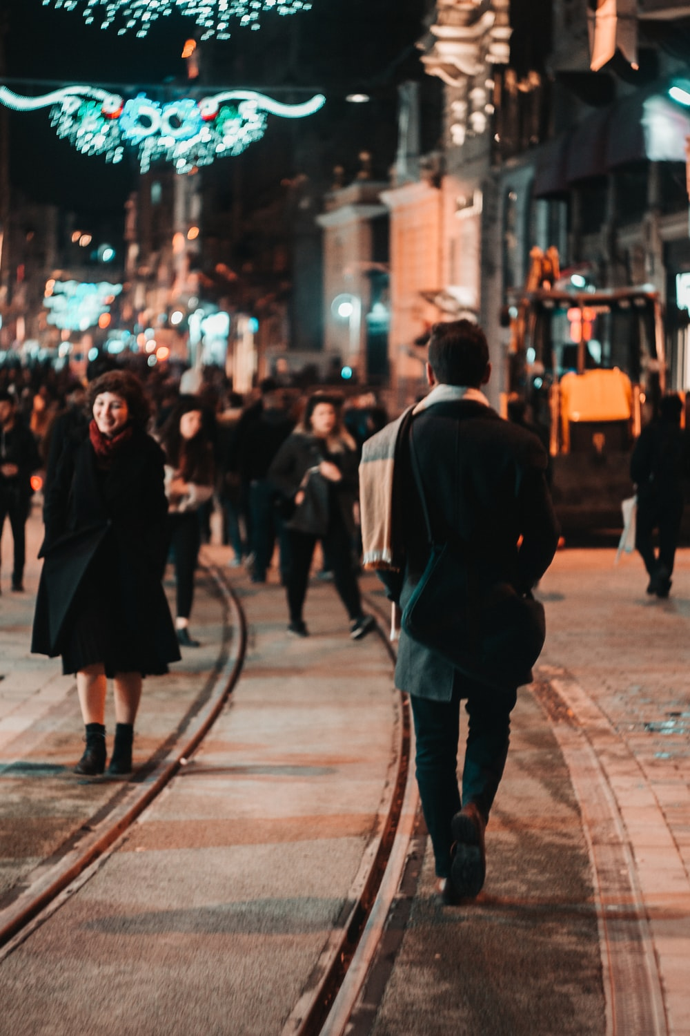people walking at the streets of the city during night