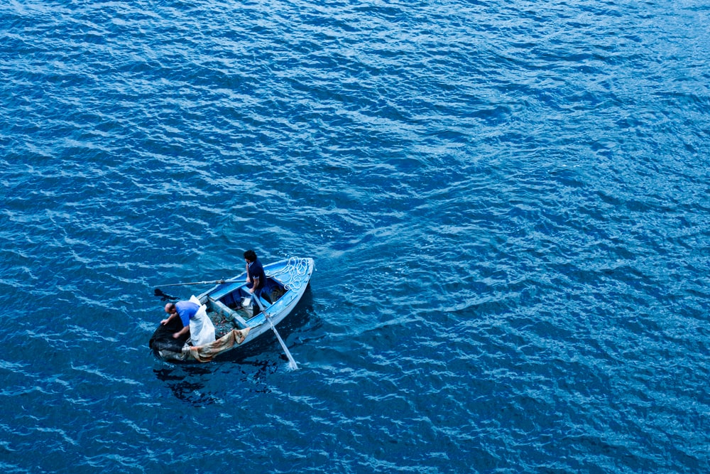 three person riding boat