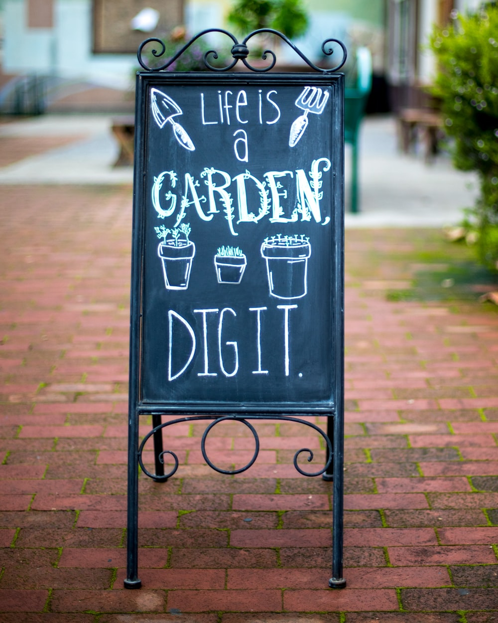 brown garden written board