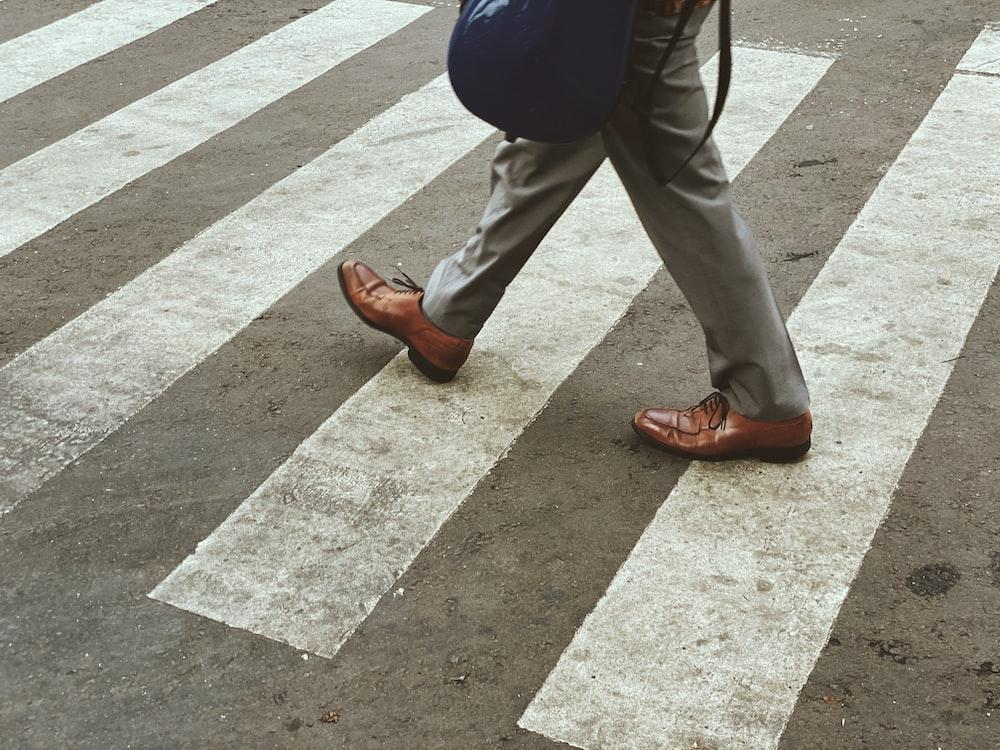 man walking across crosswalk