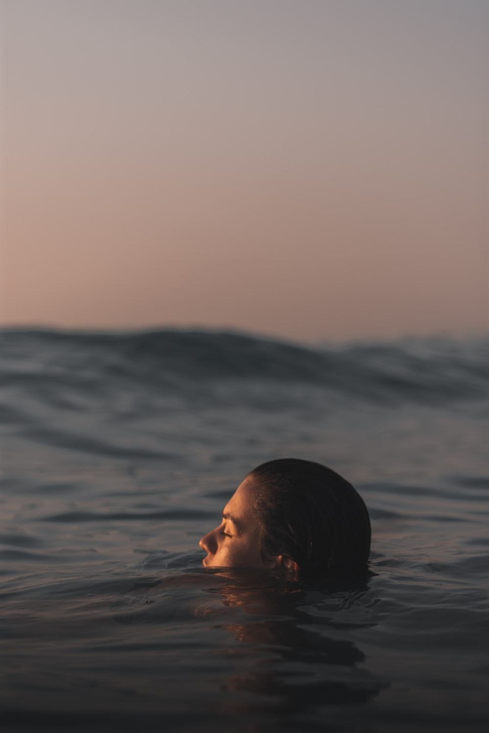 shallow focus photo of person in body of water