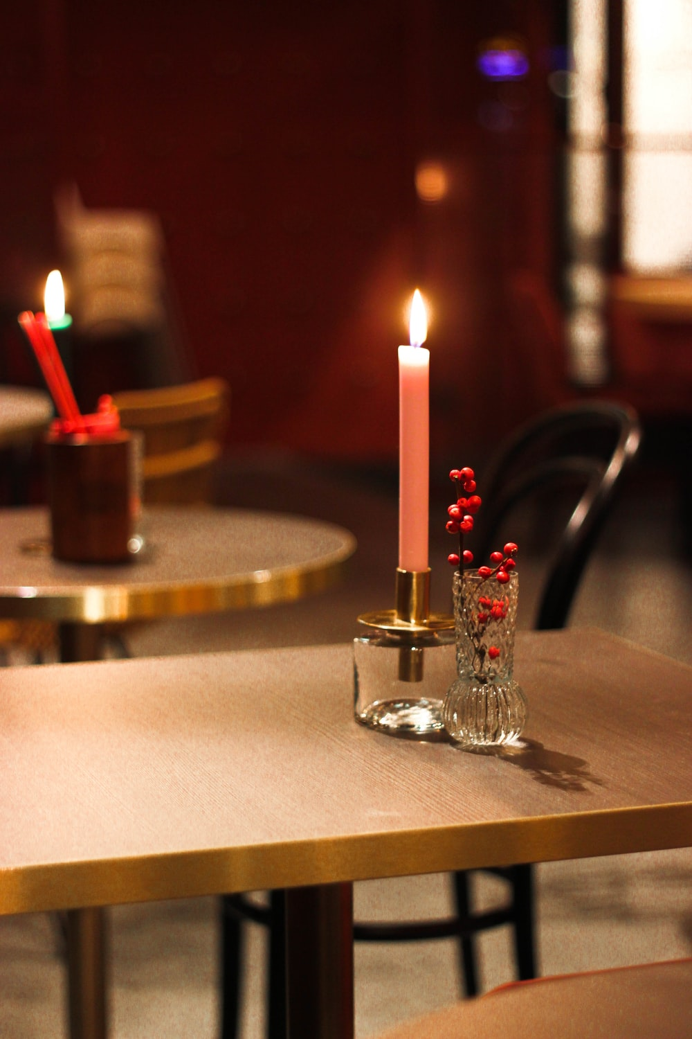 lit candle stick on holder on table