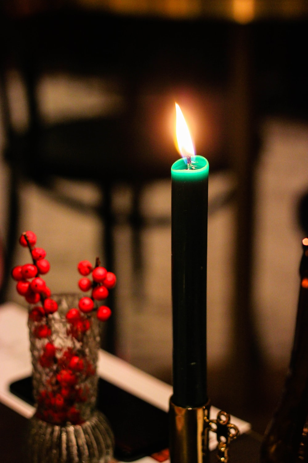 lighted green candle stick with holder