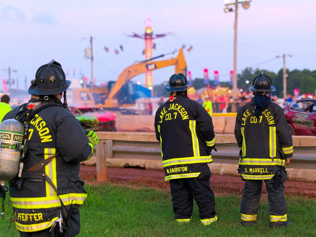 Three firefighters watch over a bumper car session in Virginia